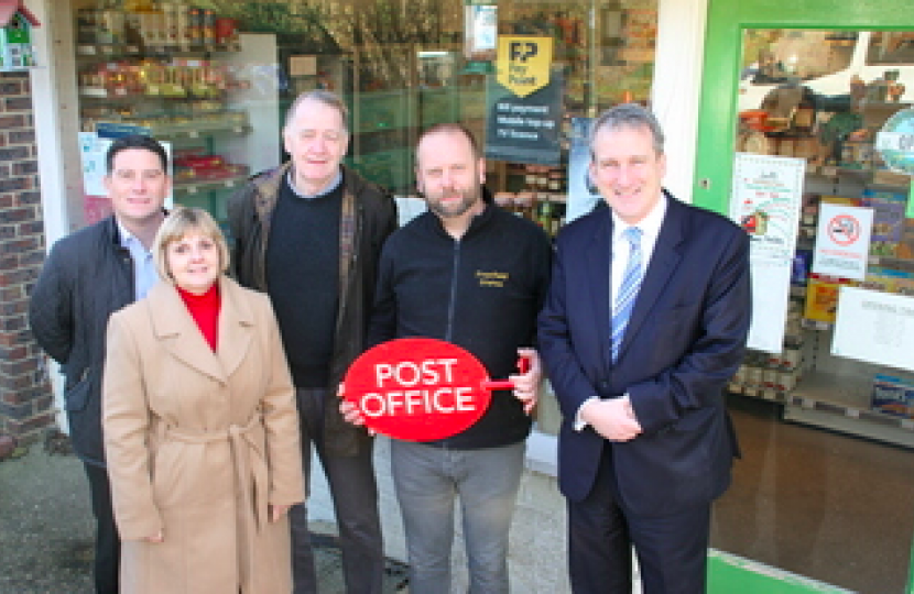Conservative Councillors Nick Drew and Julie Butler with East Hampshire MP Damian Hinds with manager of Froxfield Stores, Howard Bevis as the Post Office returns to Froxfield Stores with an opening date of the 29th March.